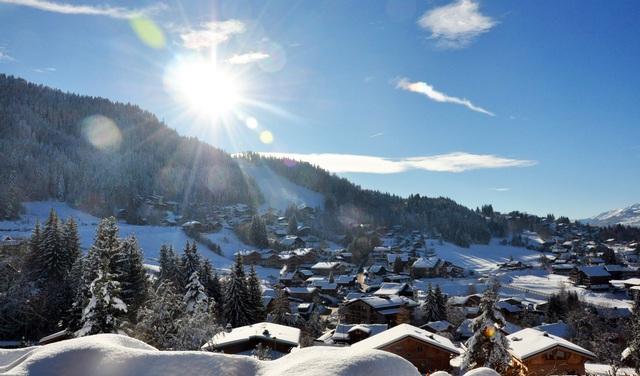 Coeur du village - pistes retour ski aux pieds